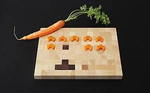Foto eines Bitboard-Schneidebrettwa mit Karotte